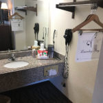 guestroom vanity and hanger space at Beachcomber Inn